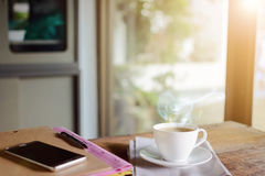 Coffee cup clock and work on table Royalty Free Stock Photography