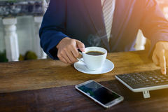 Coffee cup clock and work on table Royalty Free Stock Photos