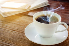 Coffee cup clock and work on table Stock Photography