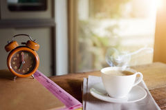 Coffee cup clock and work on table Stock Image