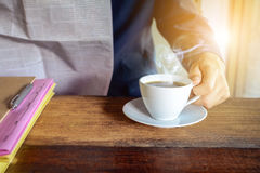 Coffee cup clock and work on table Royalty Free Stock Photo