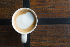 Coffee Cup. Close up white coffee cup on a brown table Royalty Free Stock Photo