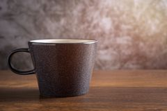 Coffee Cup. Close up Coffee Cup on wooden Table and Sun side Light in the morning with Space for text royalty free stock photography