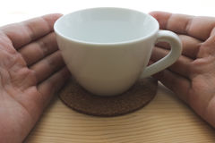 Coffee cup and coaster Royalty Free Stock Image