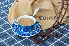 Coffee cup with coffee bag Royalty Free Stock Photography
