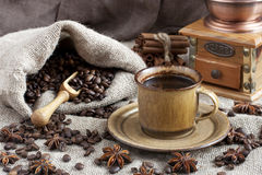 Coffee cup with coffee bag on wooden table Royalty Free Stock Photo