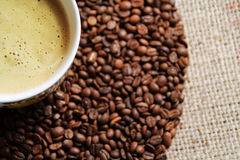 Coffee cup on coffee bean background. Top view Royalty Free Stock Image