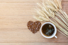 Coffee cup and coffee bean heart shape Stock Photos