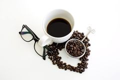 Coffee cup and coffee bean line heart shape and eyeglasses on wh Stock Photos