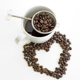 Coffee cup and coffee bean line heart shape on white background Royalty Free Stock Image