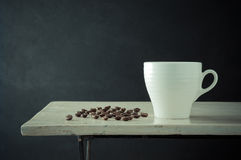 Coffee cup and coffee bean Royalty Free Stock Photography