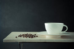 Coffee cup and coffee bean Stock Photos