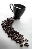 Coffee cup and coffee beans. Coffee cup with coffee beans Stock Photo