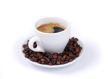 Coffee cup with coffee beans Stock Photography