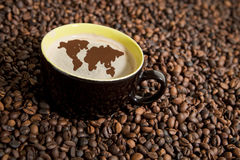 Coffee cup in coffee beans Stock Photo