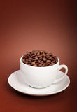 Coffee cup with coffee beans Royalty Free Stock Image
