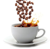 Coffee cup and coffee beans Royalty Free Stock Photo