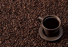 Coffee cup on coffee beans Stock Photo