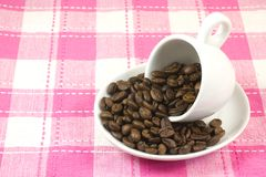 Coffee cup and coffee beans Stock Photography