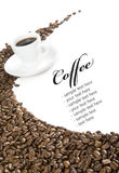 Coffee cup on coffee beans Royalty Free Stock Images