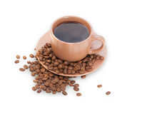 Coffee cup with coffee beans around crumbles, isolated Royalty Free Stock Photography