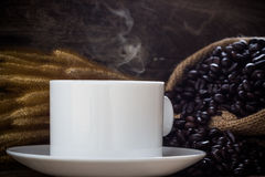 Coffee cup and coffee beans. Background Royalty Free Stock Photography