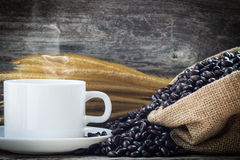 Coffee cup and coffee beans. Background Stock Photo