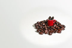Coffee cup on coffee beans background. Royalty Free Stock Images