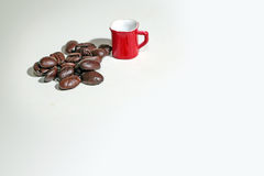 Coffee cup on coffee beans background. Royalty Free Stock Image