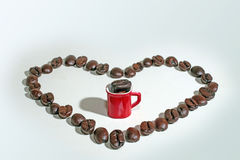 Coffee cup on coffee beans background. Stock Images