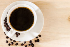 Coffee cup and coffee beans background royalty free stock images