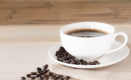 Coffee cup and coffee beans background royalty free stock photos
