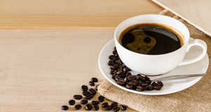 Coffee cup and coffee beans background stock images