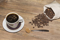 Coffee Cup and coffee beans in bag Stock Photos