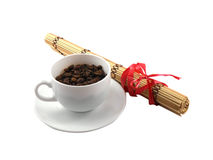 Coffee cup with coffee beans and bamboo on white Royalty Free Stock Images