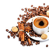 Coffee cup with coffee beans and biscotti Royalty Free Stock Image