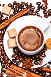 Coffee cup with coffee beans and biscotti Royalty Free Stock Photo