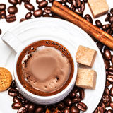 Coffee cup with coffee beans and biscotti Stock Photo
