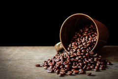 Coffee cup and coffee beans on black background Royalty Free Stock Photography