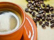 Coffee cup and coffee beans Royalty Free Stock Image