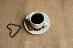 Coffee cup with coffee beans on burlap stock photos