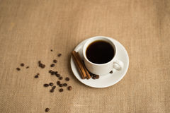 Coffee cup with coffee beans on burlap stock photo