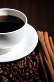 Coffee cup, coffee beans and cinnamon. Royalty Free Stock Photography