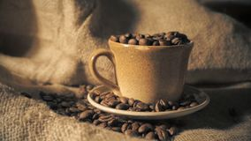 Coffee cup and coffee beans.  stock video