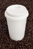 Coffee Cup on Coffee Beans Stock Images