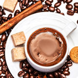 Coffee cup with coffee beans  isolated on white Stock Photography