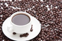 Coffee in a cup and coffee beans. Morning time coffee in a cup royalty free stock photography