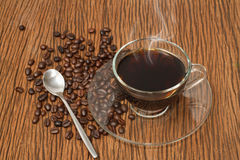 Coffee cup and coffee beans Stock Photos