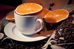 Coffee cup with coffee beans, orange and lemon Royalty Free Stock Photo