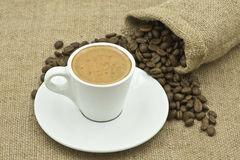 Coffee Cup Beside Coffee Beans on Sacking Stock Images